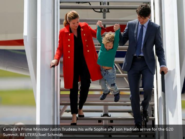 Canada's Prime Minister Justin Trudeau his wife Sophie and son Hadrien arrive for the G20 Summit. REUTERS/Axel Schmidt