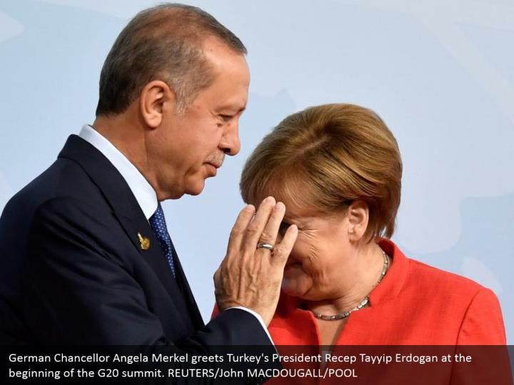 German Chancellor Angela Merkel greets Turkey's President Recep Tayyip Erdogan at the beginning of the G20 summit. REUTERS/John MACDOUGALL/POOL