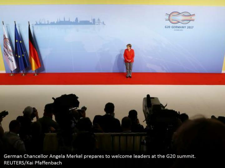 German Chancellor Angela Merkel prepares to welcome leaders at the G20 summit. REUTERS/Kai Pfaffenbach