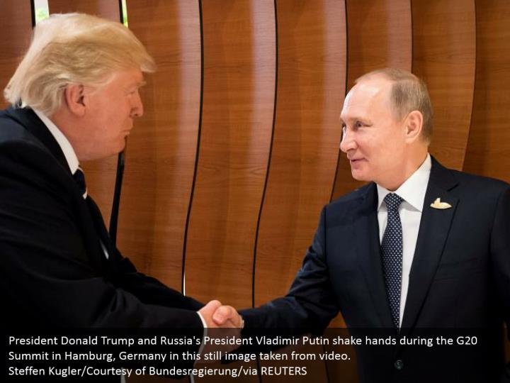 President Donald Trump and Russia's President Vladimir Putin shake hands during the G20 Summit in Hamburg, Germany in this still image taken from video.  Steffen Kugler/Courtesy of Bundesregierung/via REUTERS