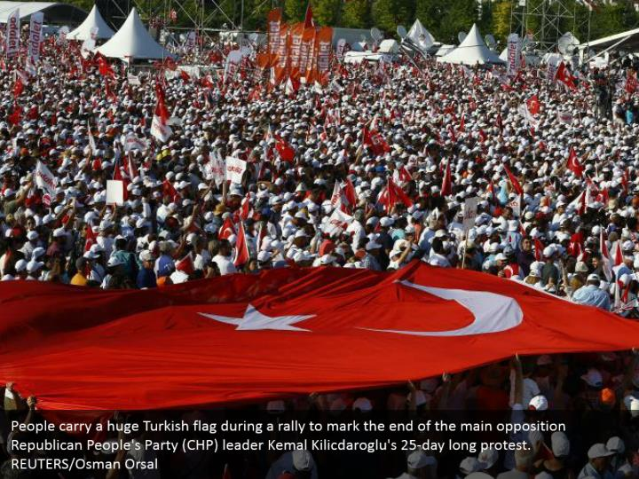 People carry a huge Turkish flag during a rally to mark the end of the main opposition Republican People's Party (CHP) leader Kemal Kilicdaroglu's 25-day long protest.  REUTERS/Osman Orsal