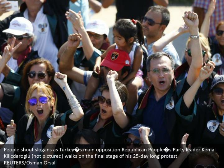 People shout slogans as Turkey�s main opposition Republican People�s Party leader Kemal Kilicdaroglu (not pictured) walks on the final stage of his 25-day long protest.  REUTERS/Osman Orsal