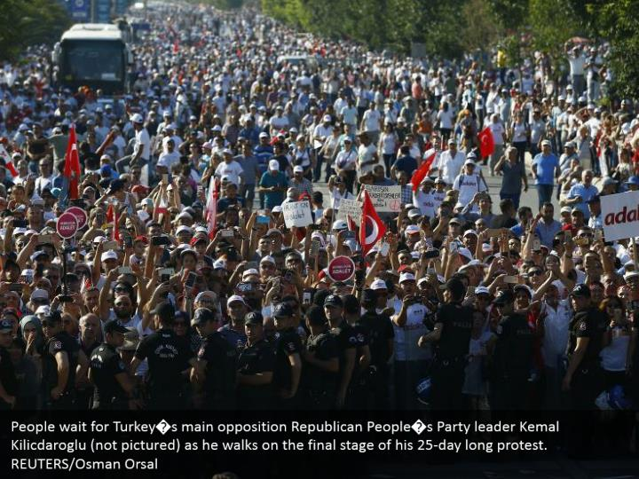 People wait for Turkey�s main opposition Republican People�s Party leader Kemal Kilicdaroglu (not pictured) as he walks on the final stage of his 25-day long protest. REUTERS/Osman Orsal