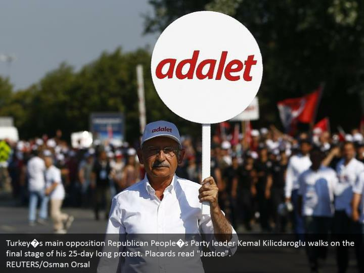 """Turkey�s main opposition Republican People�s Party leader Kemal Kilicdaroglu walks on the final stage of his 25-day long protest. Placards read """"Justice"""". REUTERS/Osman Orsal"""