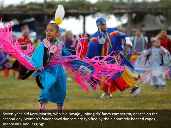 Seven-year-old Kerri Martin, who is a Navajo junior girls' fancy competitor, dances on the second day. Women's fancy shawl dancers are typified by the elaborately beaded capes, moccasins, and leggings.