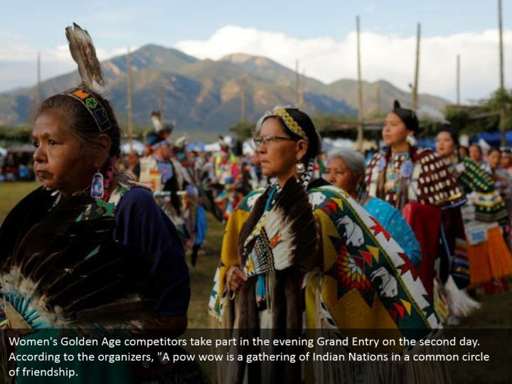 """Women's Golden Age competitors take part in the evening Grand Entry on the second day. According to the organizers, """"A pow wow is a gathering of Indian Nations in a common circle of friendship."""