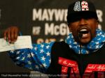 floyd mayweather holds up a check reuters lucy