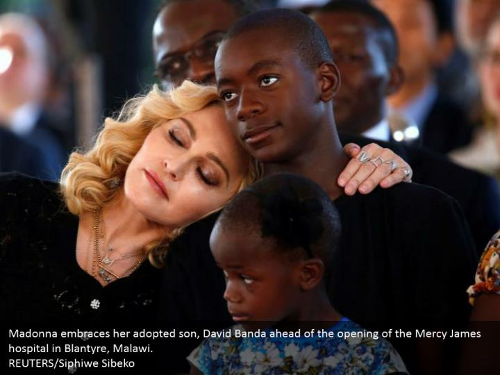 Madonna embraces her adopted son, David Banda ahead of the opening of the Mercy James hospital in Blantyre, Malawi.  REUTERS/Siphiwe Sibeko