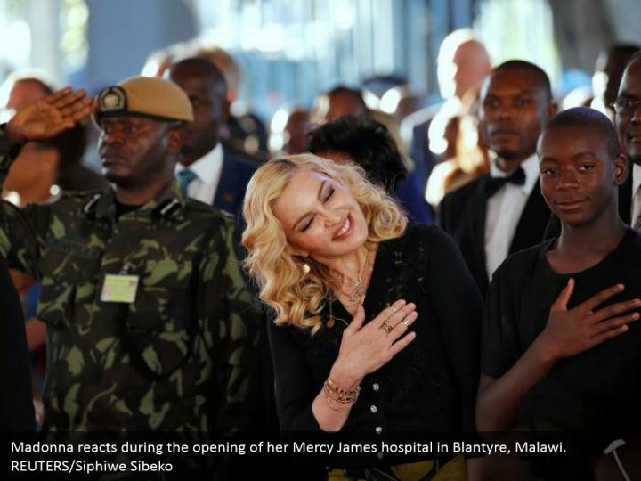 Madonna reacts during the opening of her Mercy James hospital in Blantyre, Malawi. REUTERS/Siphiwe Sibeko