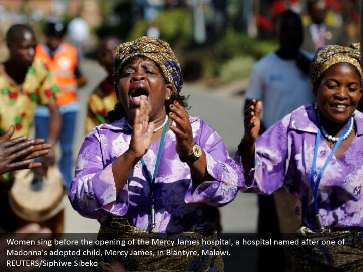 Women sing before the opening of the Mercy James hospital, a hospital named after one of Madonna's adopted child, Mercy James, in Blantyre, Malawi.  REUTERS/Siphiwe Sibeko