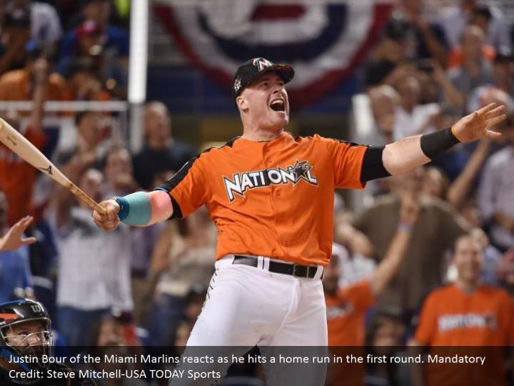 Justin Bour of the Miami Marlins reacts as he hits a home run in the first round. Mandatory Credit: Steve Mitchell-USA TODAY Sports