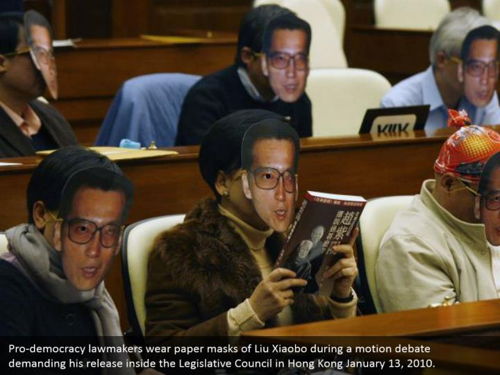Pro-democracy lawmakers wear paper masks of Liu Xiaobo during a motion debate demanding his release inside the Legislative Council in Hong Kong January 13, 2010.