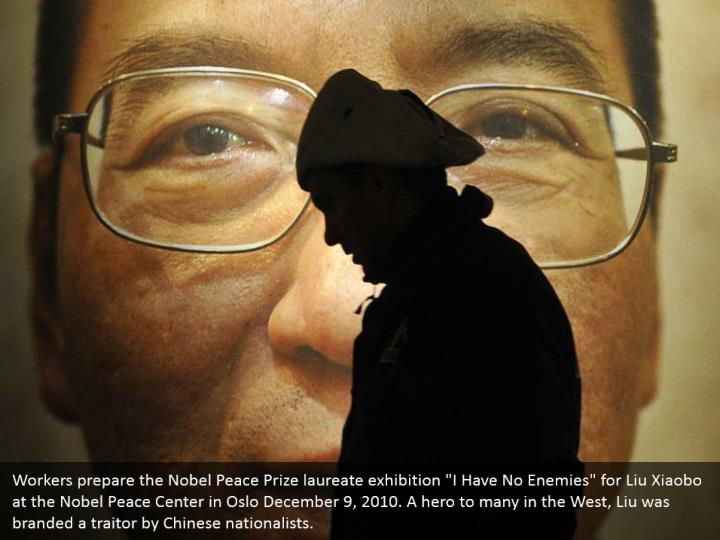 "Workers prepare the Nobel Peace Prize laureate exhibition ""I Have No Enemies"" for Liu Xiaobo at the Nobel Peace Center in Oslo December 9, 2010. A hero to many in the West, Liu was branded a traitor by Chinese nationalists."