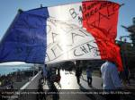 a french flag with a tribute for a victim is seen