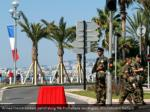 armed french soldiers patrol along the promenade