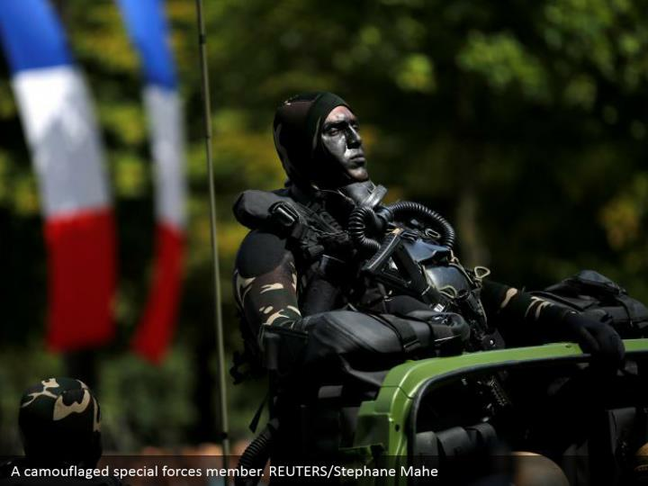 A camouflaged special forces member. REUTERS/Stephane Mahe