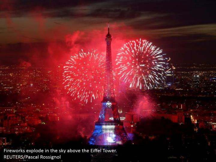 Fireworks explode in the sky above the Eiffel Tower.  REUTERS/Pascal Rossignol