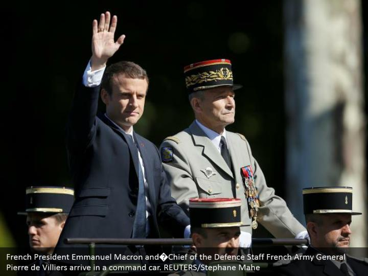 French President Emmanuel Macron and�Chief of the Defence Staff French Army General Pierre de Villiers arrive in a command car. REUTERS/Stephane Mahe