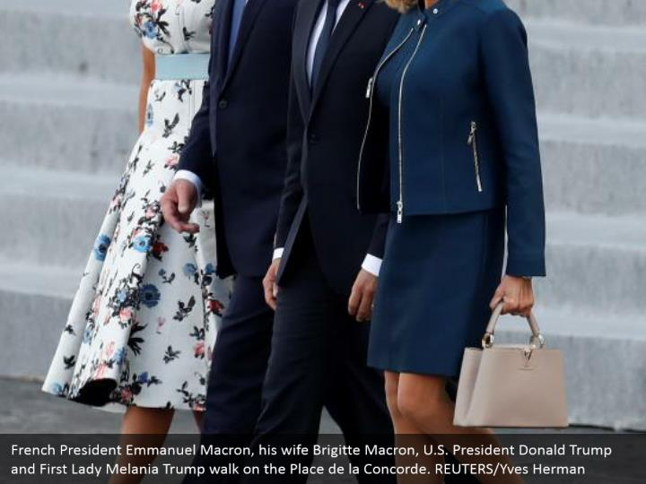 French President Emmanuel Macron, his wife Brigitte Macron, U.S. President Donald Trump and First Lady Melania Trump walk on the Place de la Concorde. REUTERS/Yves Herman