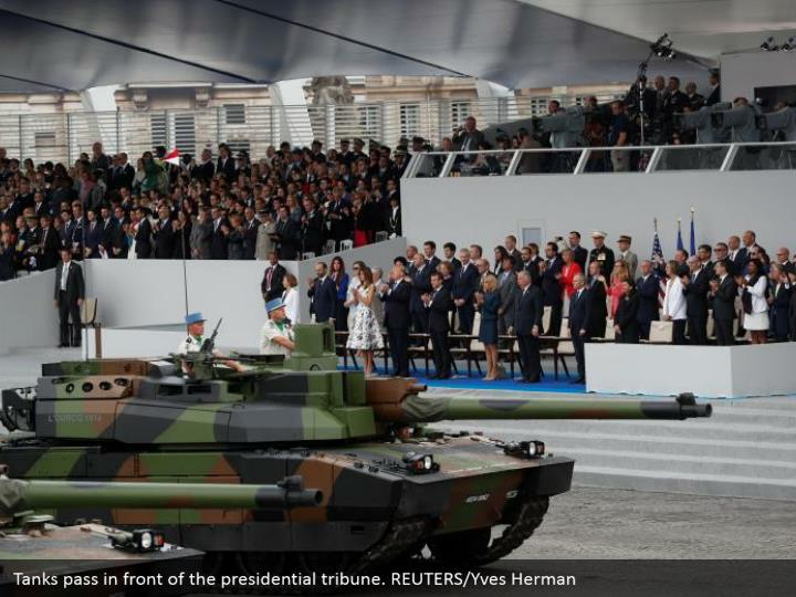 Tanks pass in front of the presidential tribune. REUTERS/Yves Herman