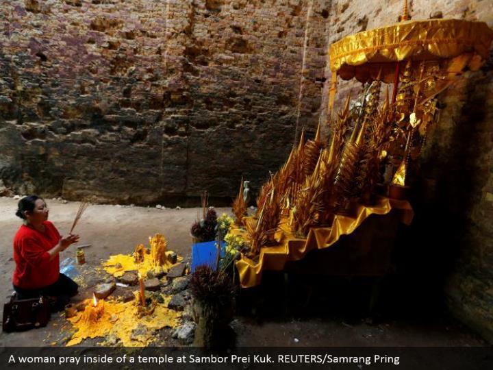 A woman pray inside of a temple at Sambor Prei Kuk. REUTERS/Samrang Pring
