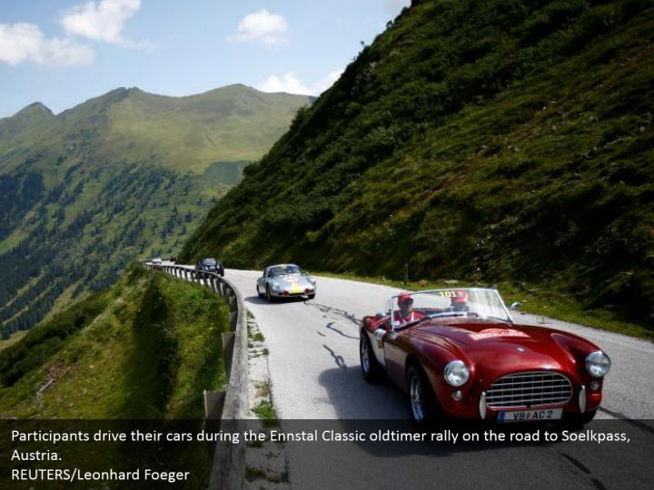 Participants drive their cars during the Ennstal Classic oldtimer rally on the road to Soelkpass, Austria.  REUTERS/Leonhard Foeger