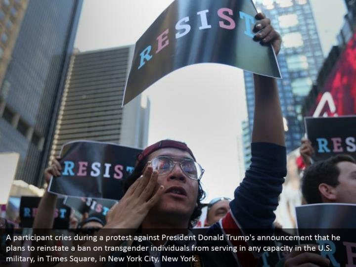 A participant cries during a protest against President Donald Trump's announcement that he plans to reinstate a ban on transgender individuals from serving in any capacity in the U.S. military, in Times Square, in New York City, New York.
