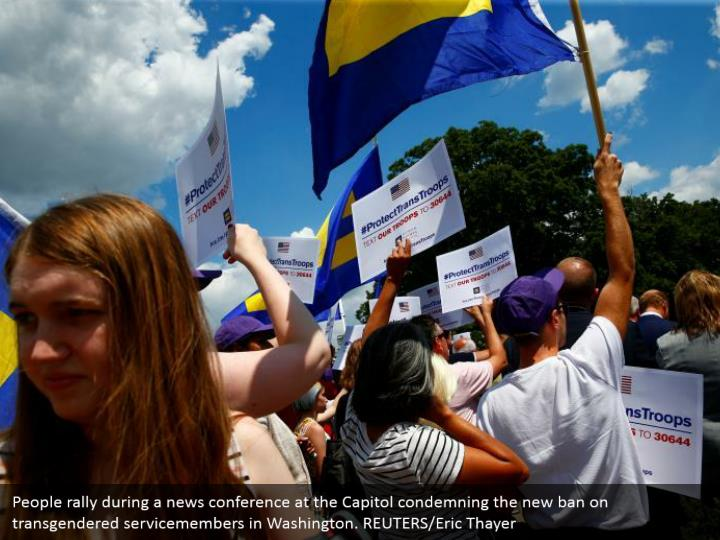 People rally during a news conference at the Capitol condemning the new ban on transgendered servicemembers in Washington. REUTERS/Eric Thayer
