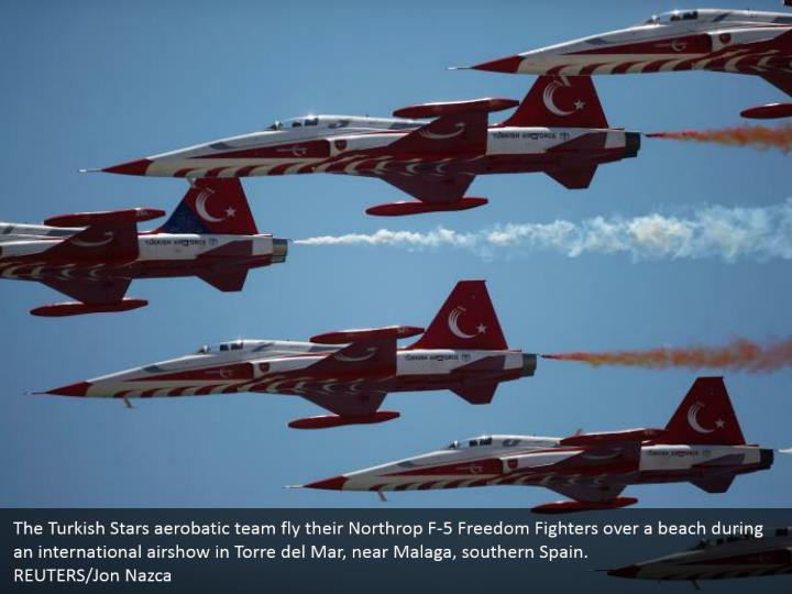 The Turkish Stars aerobatic team fly their Northrop F-5 Freedom Fighters over a beach during an international airshow in Torre del Mar, near Malaga, southern Spain.  REUTERS/Jon Nazca