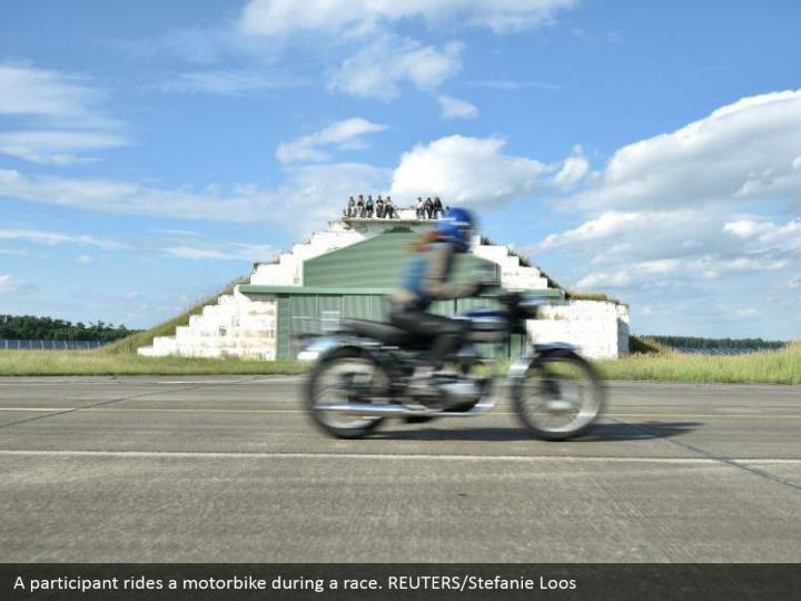 A participant rides a motorbike during a race. REUTERS/Stefanie Loos