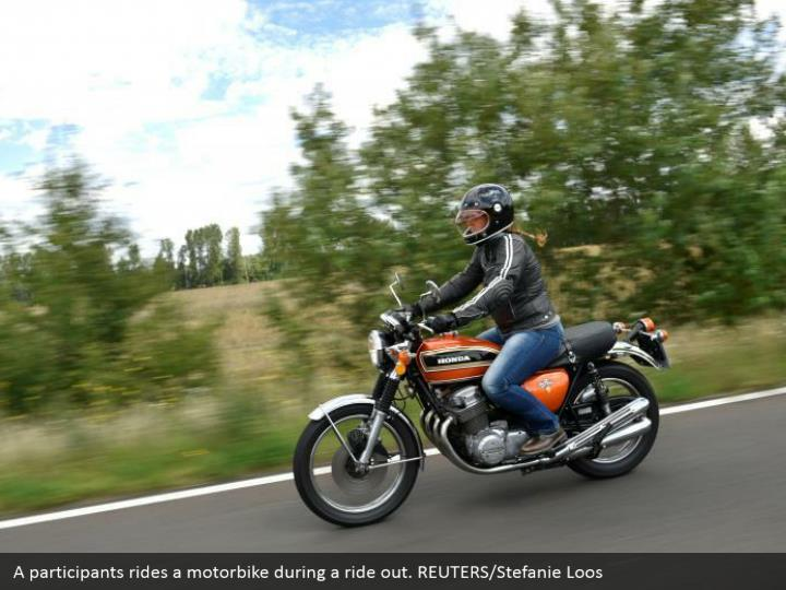 A participants rides a motorbike during a ride out. REUTERS/Stefanie Loos