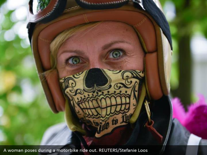 A woman poses during a motorbike ride out. REUTERS/Stefanie Loos