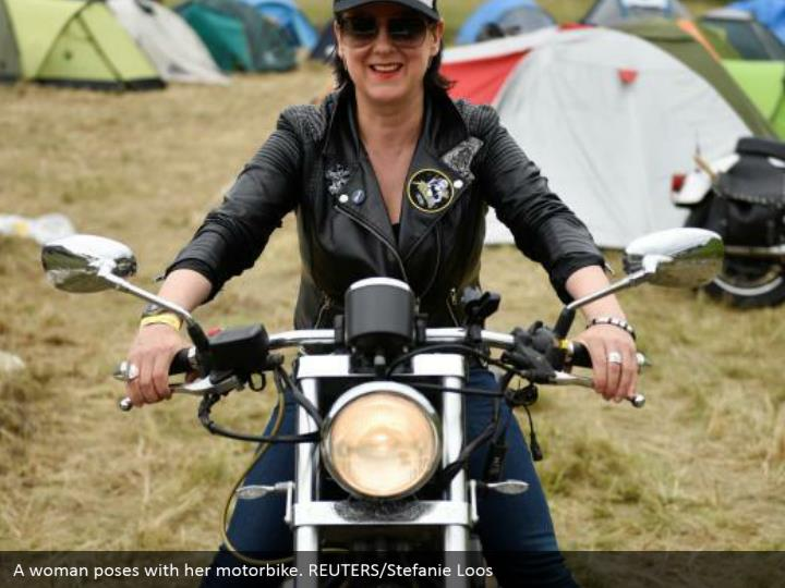 A woman poses with her motorbike. REUTERS/Stefanie Loos