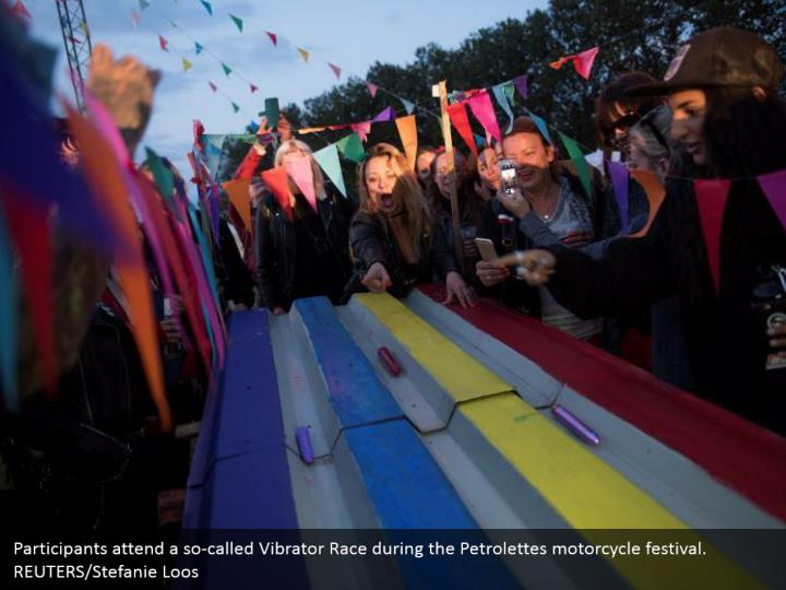 Participants attend a so-called Vibrator Race during the Petrolettes motorcycle festival. REUTERS/Stefanie Loos