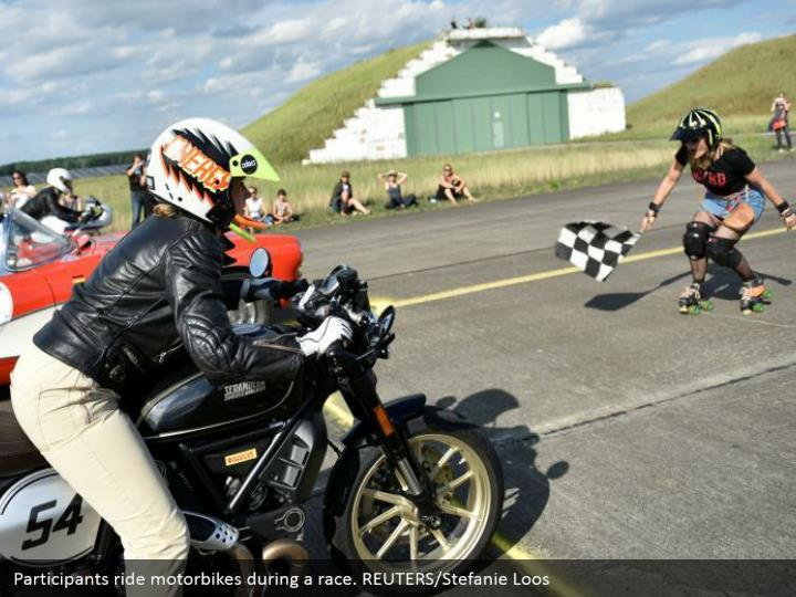 Participants ride motorbikes during a race. REUTERS/Stefanie Loos