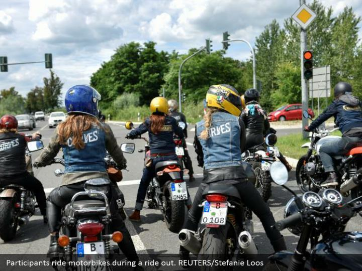 Participants ride motorbikes during a ride out. REUTERS/Stefanie Loos