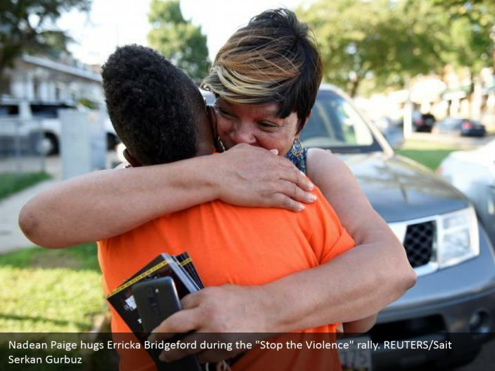 "Nadean Paige hugs Erricka Bridgeford during the ""Stop the Violence"" rally. REUTERS/Sait Serkan Gurbuz"