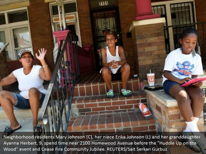 "Neighborhood residents Mary Johnson (C), her niece Erika Johnson (L) and her granddaughter Ayanna Herbert, 9, spend time near 2100 Homewood Avenue before the ""Huddle Up on the Wood"" event and Cease Fire Community Jubilee. REUTERS/Sait Serkan Gurbuz"
