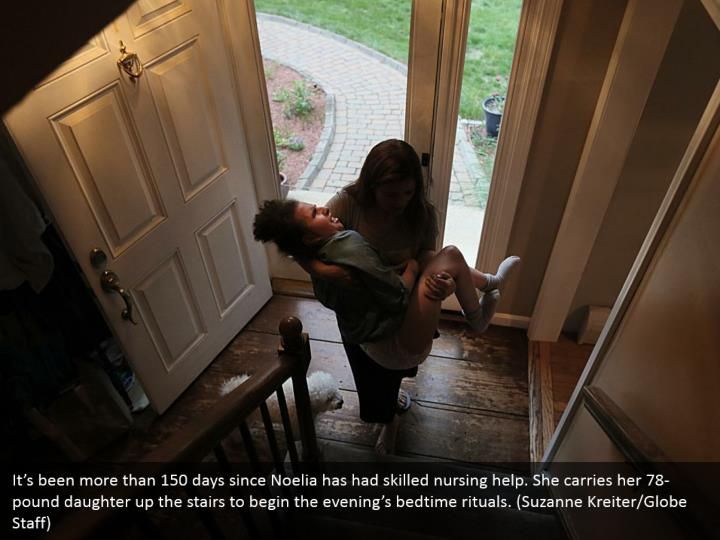 It's been more than 150 days since Noelia has had skilled nursing help. She carries her 78-pound daughter up the stairs to begin the evening's bedtime rituals. (Suzanne Kreiter/Globe Staff)