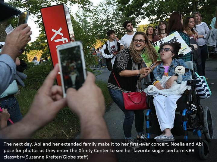 The next day, Abi and her extended family make it to her first-ever concert. Noelia and Abi pose for photos as they enter the Xfinity Center to see her favorite singer perform.<BR class=br>(Suzanne Kreiter/Globe staff)