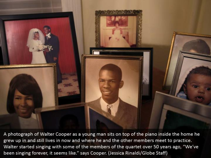 "A photograph of Walter Cooper as a young man sits on top of the piano inside the home he grew up in and still lives in now and where he and the other members meet to practice. Walter started singing with some of the members of the quartet over 50 years ago, ""We've been singing forever, it seems like."" says Cooper. (Jessica Rinaldi/Globe Staff)"