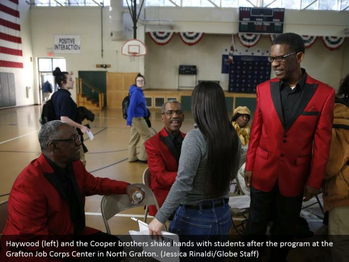Haywood (left) and the Cooper brothers shake hands with students after the program at the Grafton Job Corps Center in North Grafton. (Jessica Rinaldi/Globe Staff)