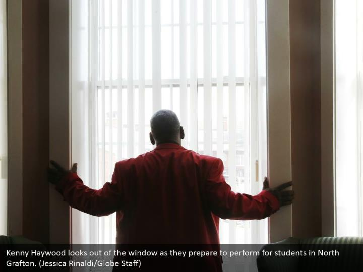 Kenny Haywood looks out of the window as they prepare to perform for students in North Grafton. (Jessica Rinaldi/Globe Staff)