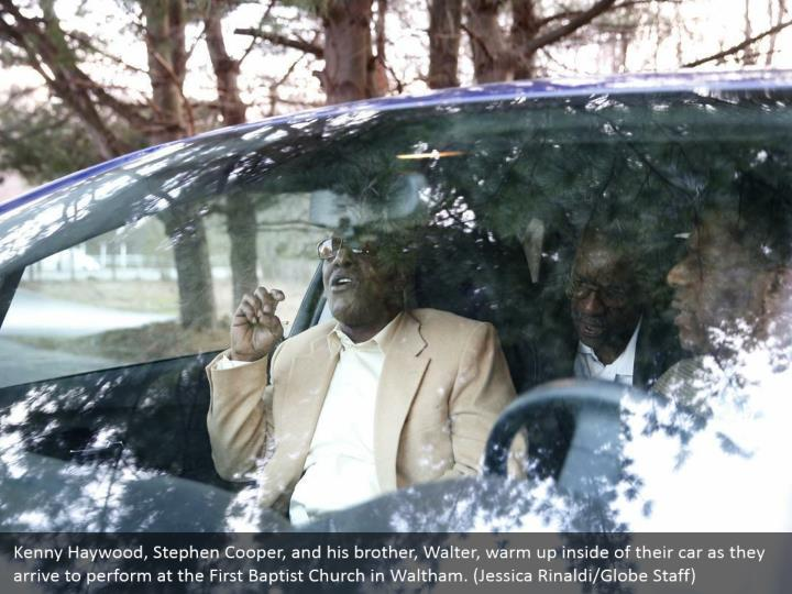 Kenny Haywood, Stephen Cooper, and his brother, Walter, warm up inside of their car as they arrive to perform at the First Baptist Church in Waltham. (Jessica Rinaldi/Globe Staff)