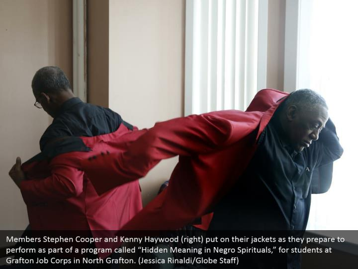 """Members Stephen Cooper and Kenny Haywood (right) put on their jackets as they prepare to perform as part of a program called """"Hidden Meaning in Negro Spirituals,"""" for students at Grafton Job Corps in North Grafton. (Jessica Rinaldi/Globe Staff)"""