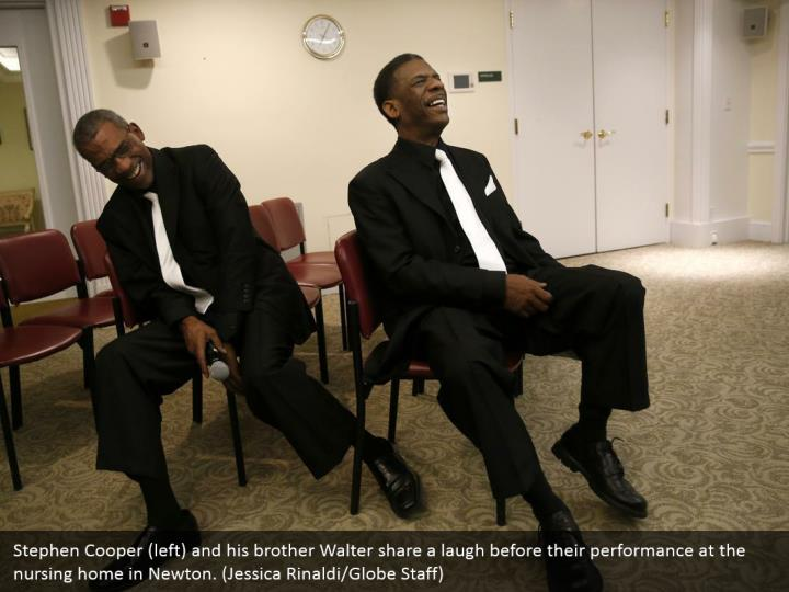 Stephen Cooper (left) and his brother Walter share a laugh before their performance at the nursing home in Newton. (Jessica Rinaldi/Globe Staff)