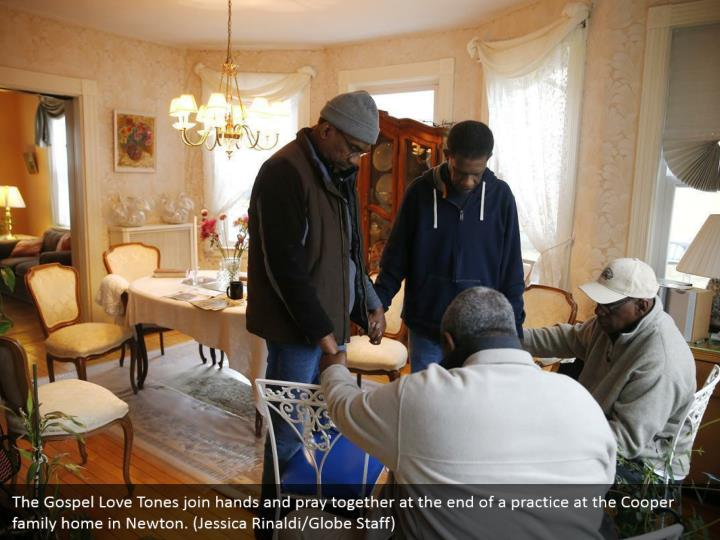 The Gospel Love Tones join hands and pray together at the end of a practice at the Cooper family home in Newton. (Jessica Rinaldi/Globe Staff)