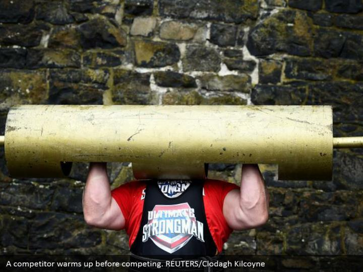 A competitor warms up before competing. REUTERS/Clodagh Kilcoyne