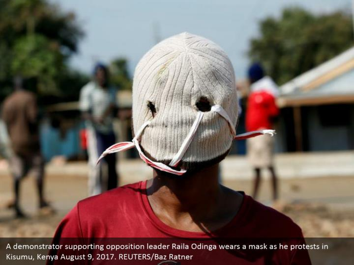 A demonstrator supporting opposition leader Raila Odinga wears a mask as he protests in Kisumu, Kenya August 9, 2017. REUTERS/Baz Ratner