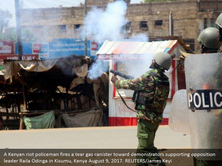 A Kenyan riot policeman fires a tear gas canister toward demonstrators supporting opposition leader Raila Odinga in Kisumu, Kenya August 9, 2017. REUTERS/James Keyi